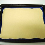 Fotografía de la masa ya extendida sobre la placa de silicona
